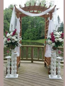 Arbor Draped with White Rental Spindles