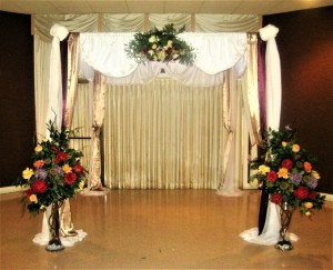 Altar / Chuppah Decorated with Swag and Large Rose Vases
